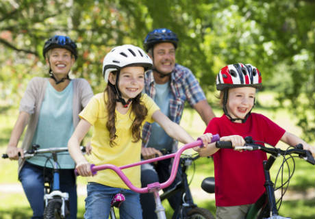 A family cycling and smiling