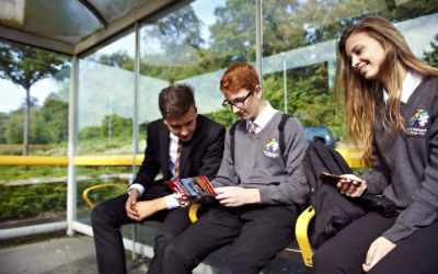 Young people sitting at a bus stop