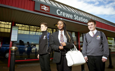 School children standing outside the entrance to Crewe Train Station