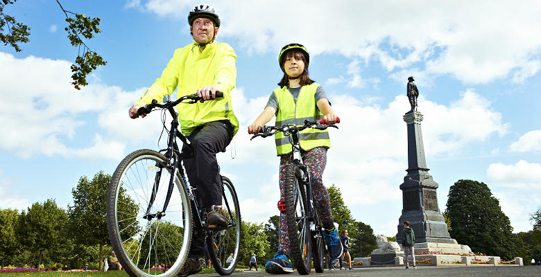 Cyclists in Crewe Park wearing high visibility jackets