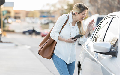 Woman greets ride share driver