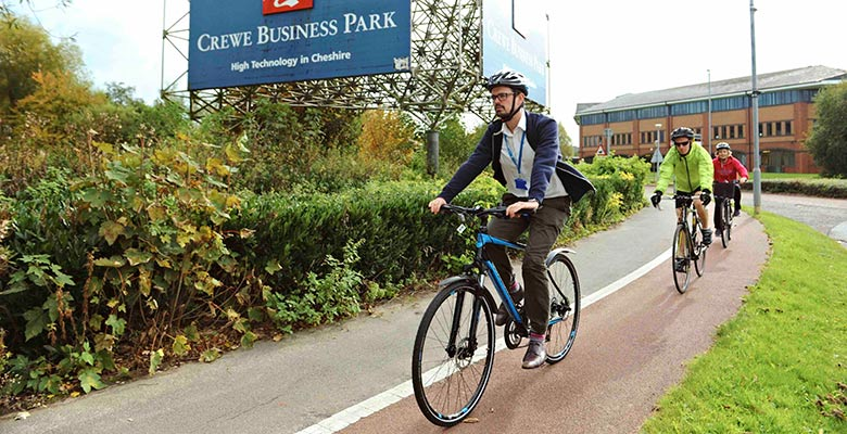 Cyclists passing Crewe Business Park